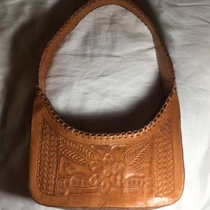 Leaders in Leather stamped and braided leather bag